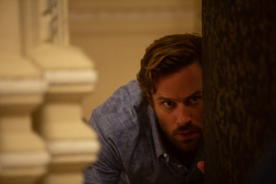 "David (Armie Hammer) fights for his life in the heart-pounding true story ""Hotel Mumbai."""