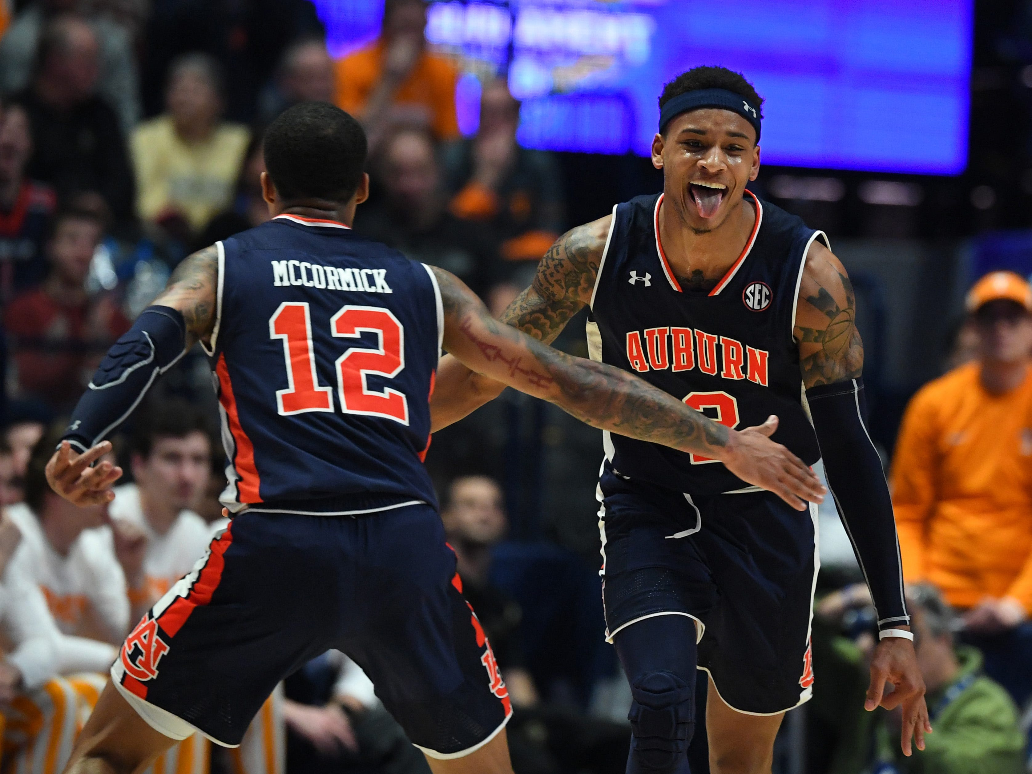 Bryce Brown and J'Von McCormick celebrate after a basket.