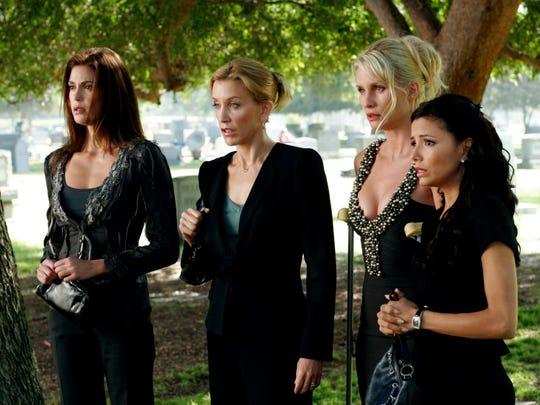 "Teri Hatcher, far left, Felicity Huffman, Nicollette Sheridan and Eva Longoria film ""Desperate Housewives."""