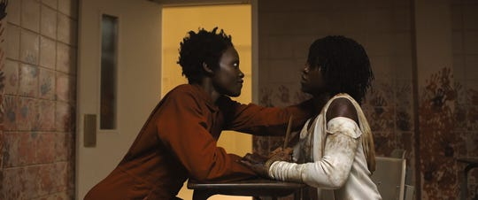 "Doppelganger Red (Lupita Nyong'o) terrorizes Adelaide Wilson (also Nyong'o)  in the horror film ""Us."""