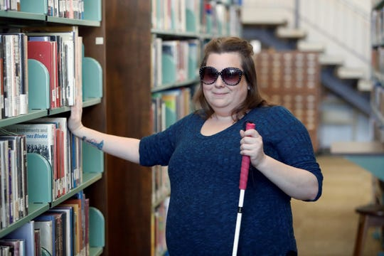 Sarah Theubet at the Shasta College Library in Redding, Calif. on March 12, 2019. Sarah, 38, has type 1 diabetes that robbed her of her vision in one eye and will eventually render her blind.  She uses a blind cane because has no sight in her left eye and has tunnel vision in her right eye due to diabetes. She also has glaucoma and cataracts. Theubet said her daughter is 16 and she hopes to still be able to see her daughter graduate high school.