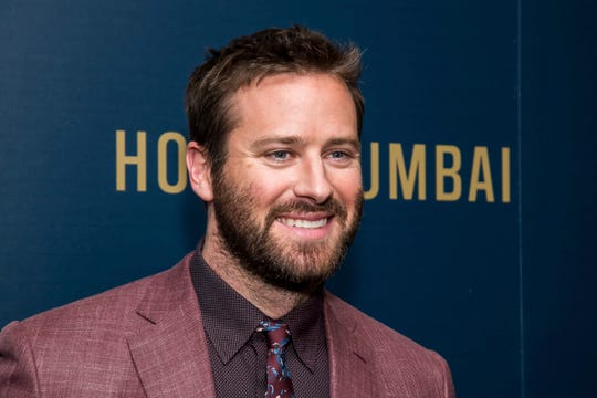 "Armie Hammer walks the ""Hotel Mumbai"" red carpet in New York on Sunday."