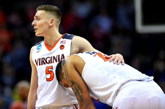 Virginia guard Kyle Guy (5) and forward Isaiah Wilkins (21) react to their upset loss to UMBC Retrievers in the first round of the 2018 NCAA tournament.