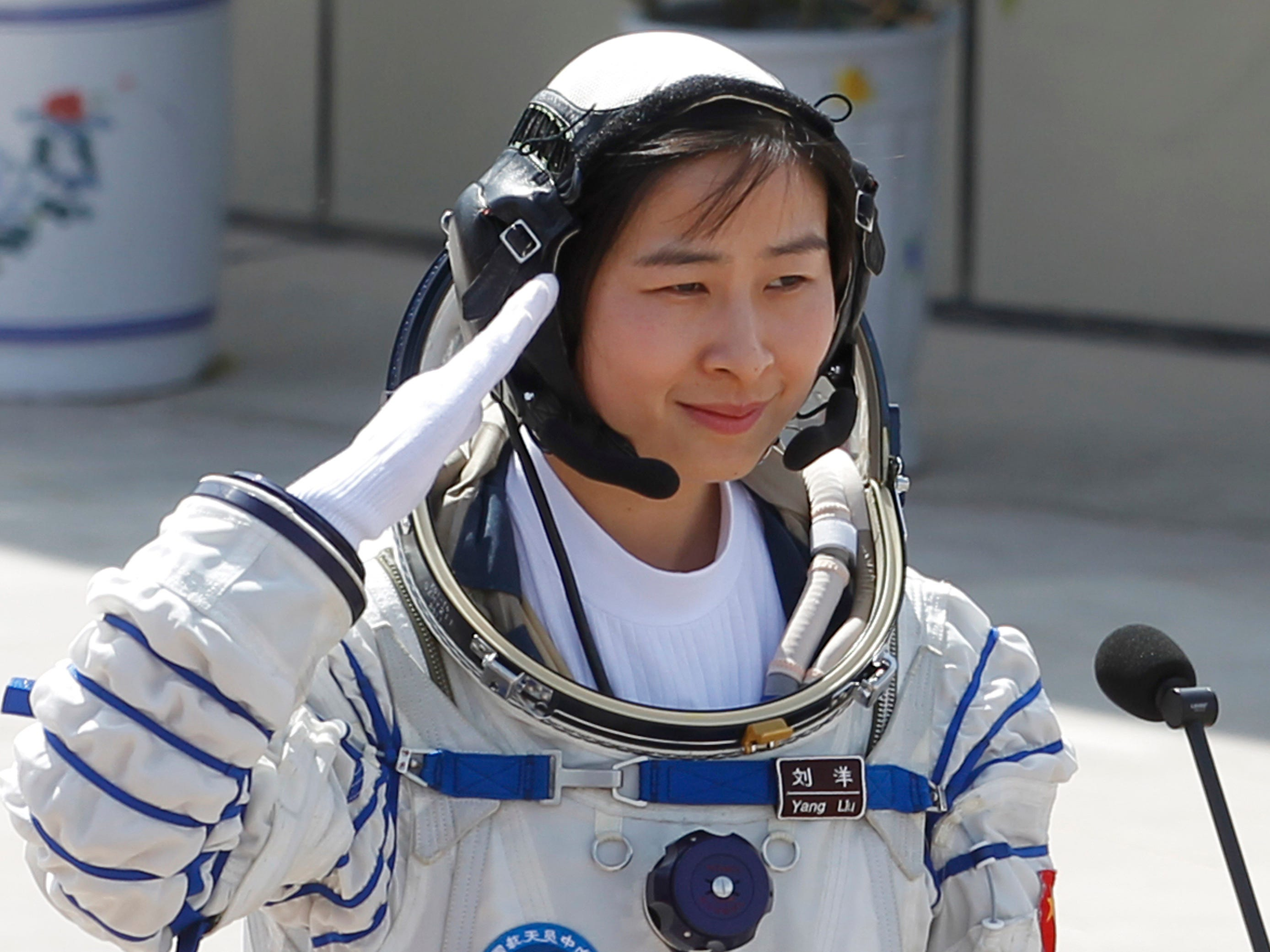China's first female astronaut Liu Yang salutes during a sending off ceremony as she departs for the Shenzhou 9 spacecraft rocket launch pad at the Jiuquan Satellite Launch Center in Jiuquan, China, Saturday, June 16, 2012. China sent its first woman and two other astronauts into space Saturday to work on a temporary space station for about a week, in a key step toward becoming only the third nation to set up a permanent base in orbit.