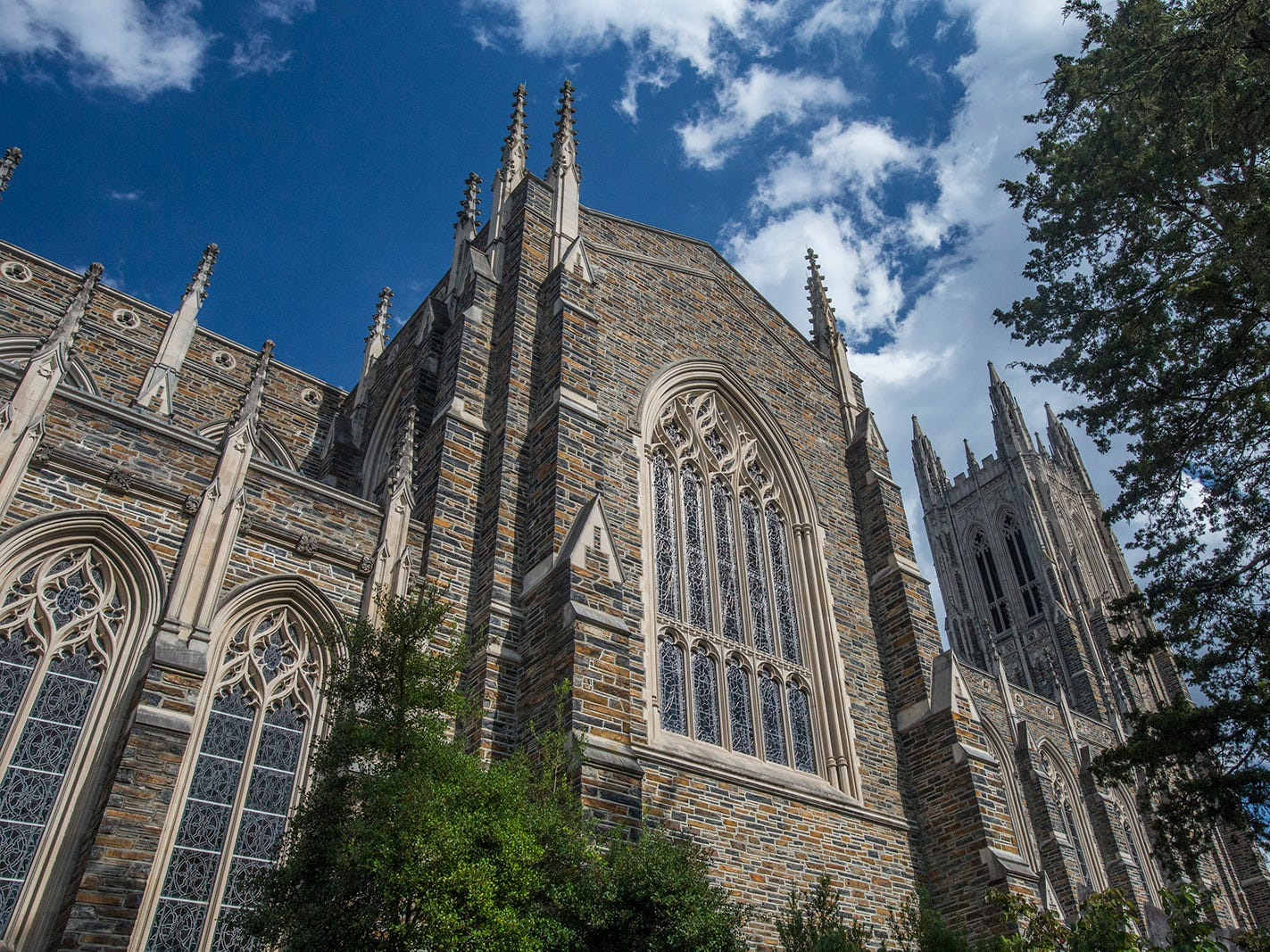 North Carolina: Duke University Chapel, with a tower that rises 210 feet, is built of multihued stones from a nearby quarry. Designed by Julian Abele and dedicated in 1935, the chapel represents last great collegiate Gothic projects in the United States.