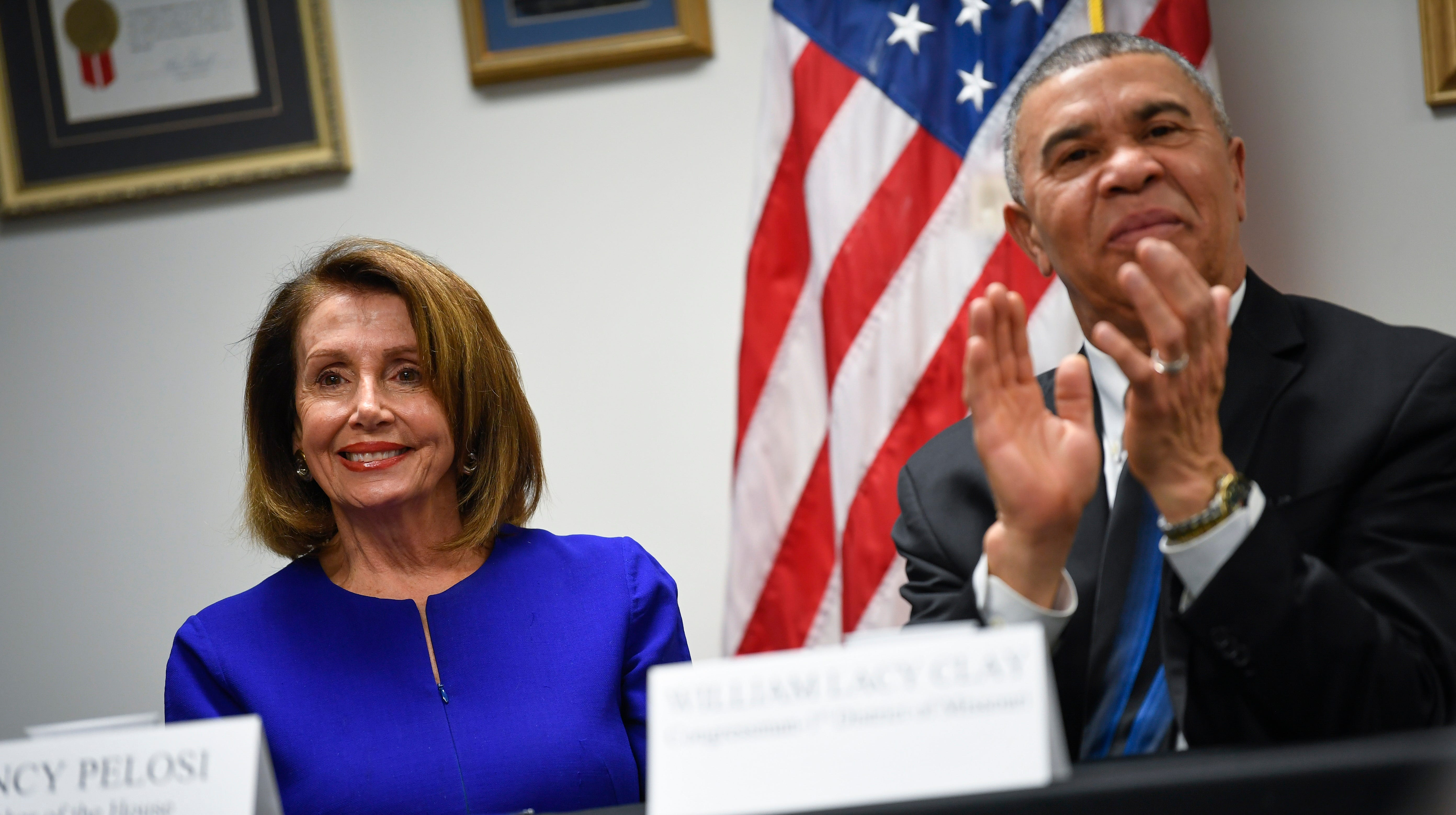 Speaker of the House Nancy Pelosi is pictured with Missouri Democratic Rep. William Lacy Clay March 18, 2019 in St. Louis, Mo. Pelosi said impeachment would be a gift to President Donald Trump, unless they could get GOP support.