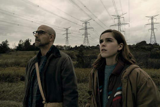 Stanley Tucci, left, and Kiernan Shipka star in the April Netflix horror film, 'The Silence.'