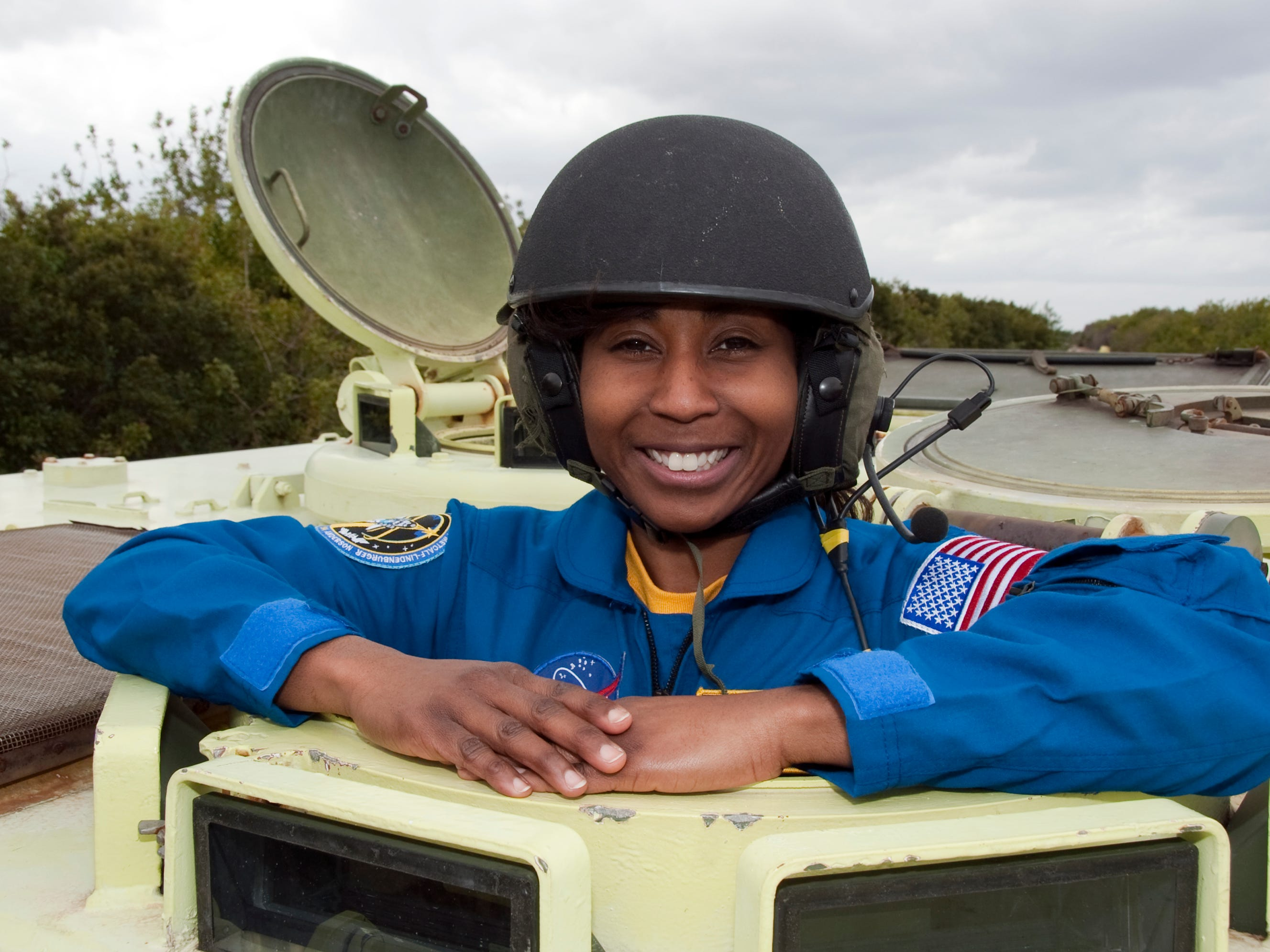 At NASA's Kennedy Space Center in Florida, STS-131 Mission Specialist Stephanie Wilson prepares to practice driving an M-113 armored personnel carrier. Wilson is the second African American woman to go into space, after Mae Jemison. Her 42 days in space are the most of any African American astronaut, male or female.