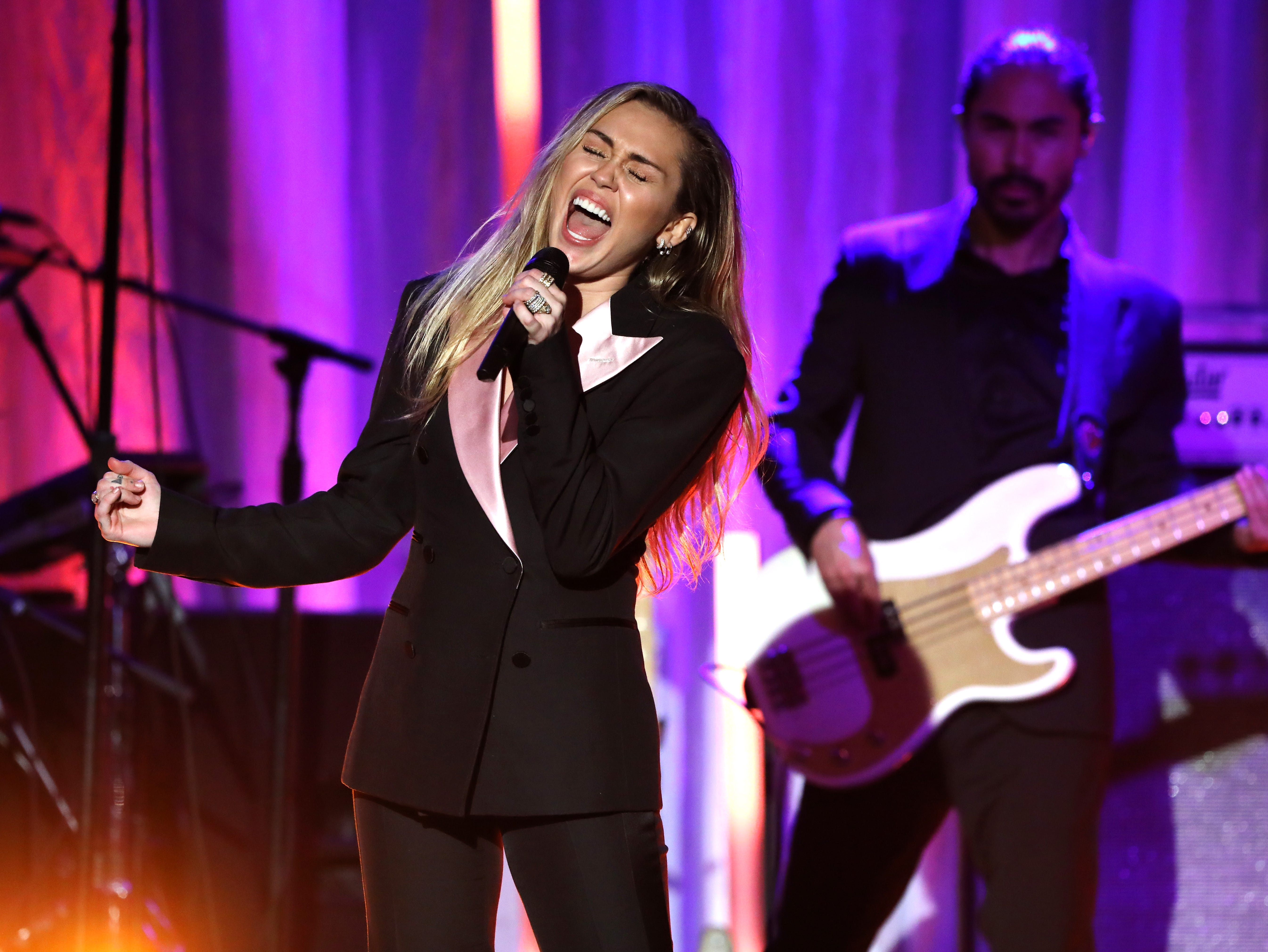 "BEVERLY HILLS, CA - FEBRUARY 28:  Miley Cyrus performs onstage during WCRF's ""An Unforgettable Evening"" at the Beverly Wilshire Four Seasons Hotel on February 28, 2019 in Beverly Hills, California.  (Photo by Rachel Murray/Getty Images for WCRF) ORG XMIT: 775305179 ORIG FILE ID: 1128311961"