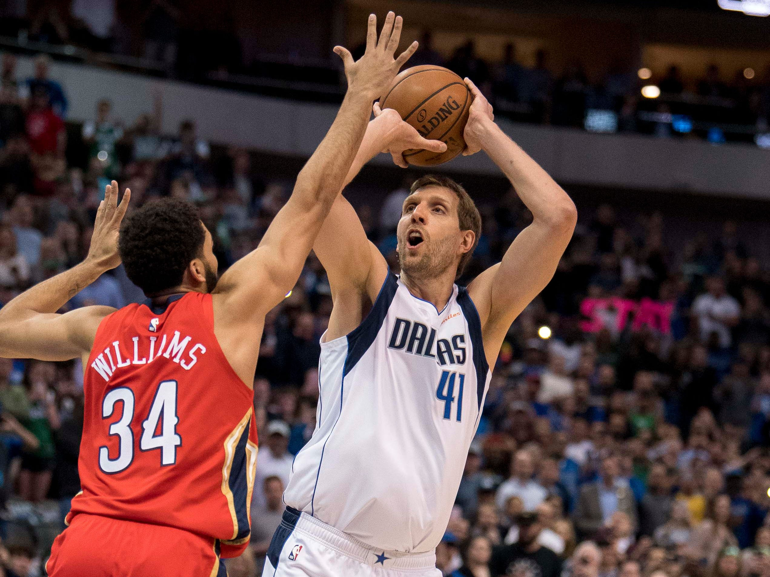 March 18: Mavericks forward Dirk Nowitzki (41) shoots and scores to pass Wilt Chamberlain for sixth place on the NBA's all-time scoring list.