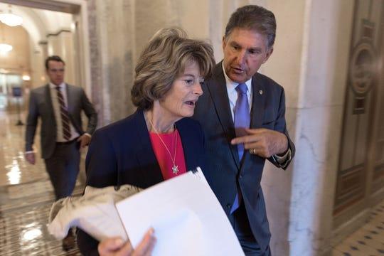 Sens. Lisa Murkowski and Joe Manchin at the U.S. Capitol on Aug. 23, 2018.