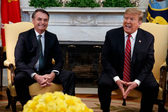 President Donald Trump speaks during a meeting with Brazilian President Jair Bolsonaro in the Oval Office of the White House March 19, 2019, in Washington.