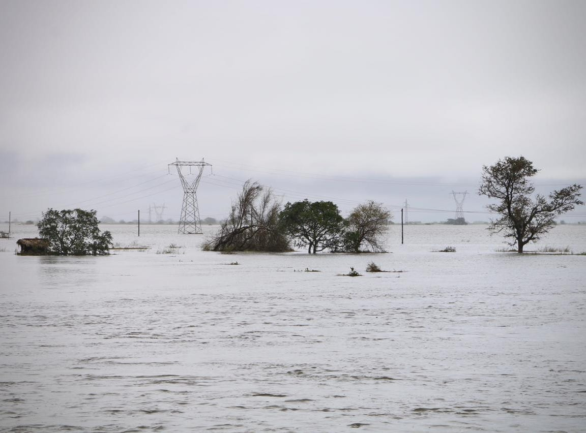 Vegetation, utility poles, and electrical pylons are flooded in the coastal city of Beira in central Mozambique on March 19, 2019, after the area was hit by the Cyclone Idai.