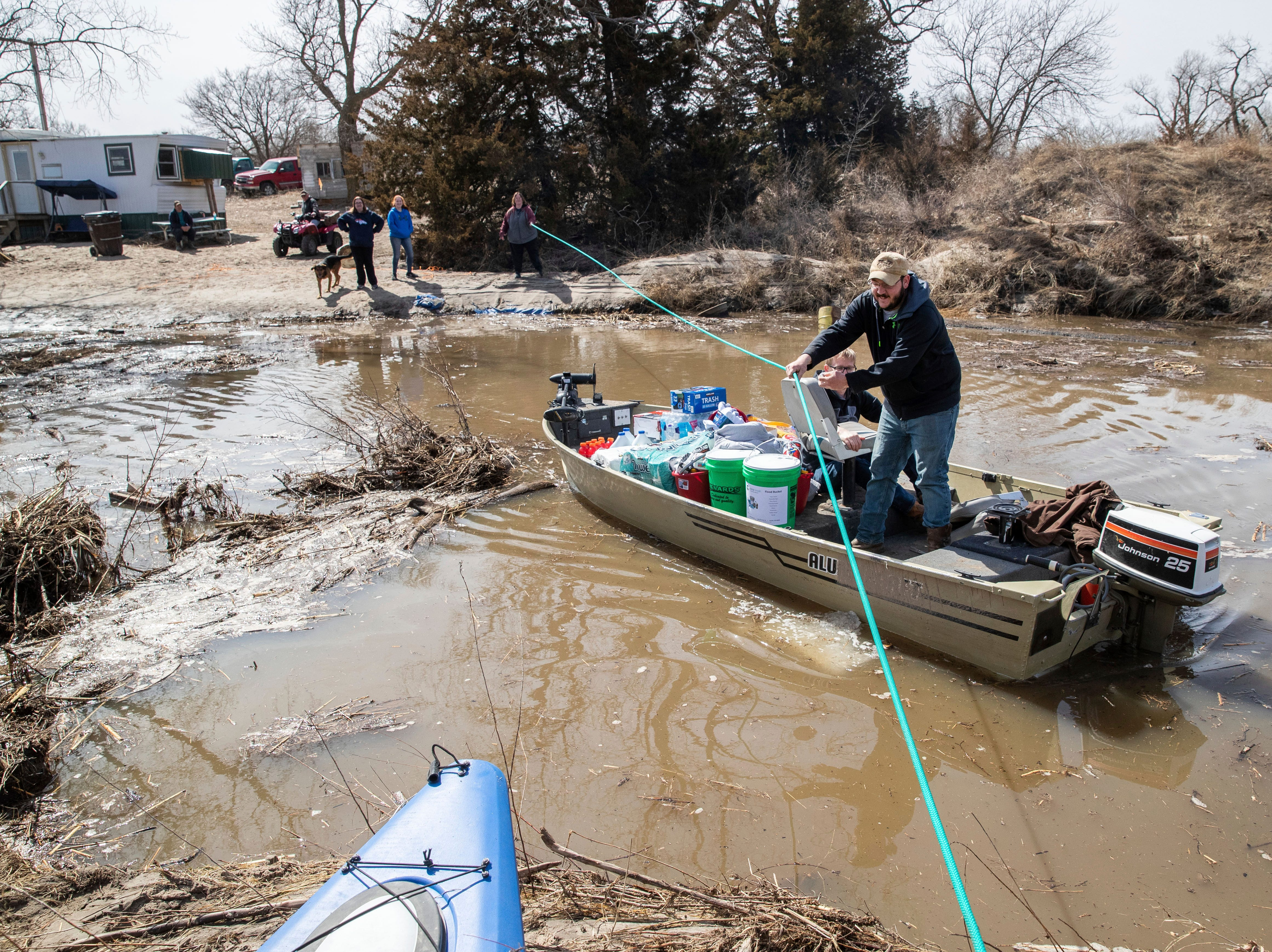 Andrew Bauer and Shawn Shonerd bring in supplies to the Bellwood, Neb. area, March 18, 2019. Much of the area was heavily impacted by flooding along the Platte River.