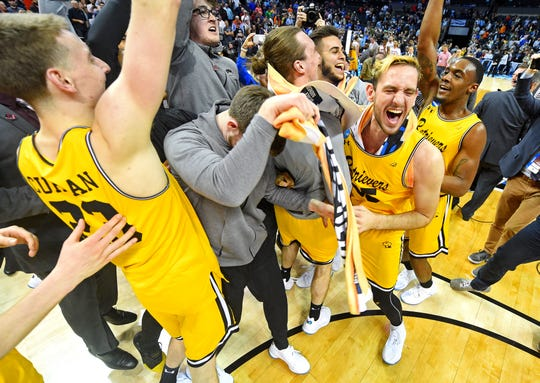 UMBC Retrievers celebrates beating the Virginia Cavaliers in the first round of the 2018 NCAA Tournament.