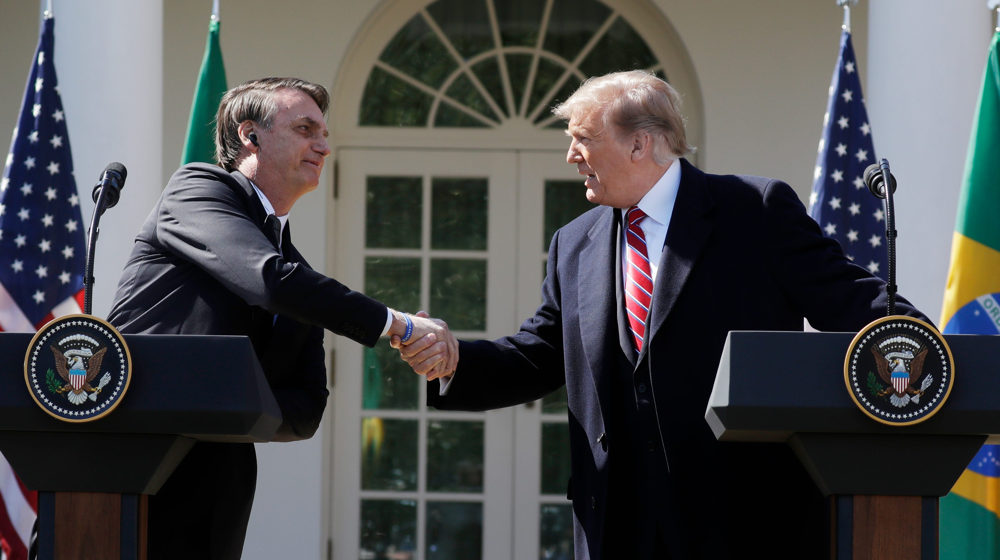 President Donald Trump greets Brazilian President Jair Bolsonaro during a news conference in the Rose Garden.