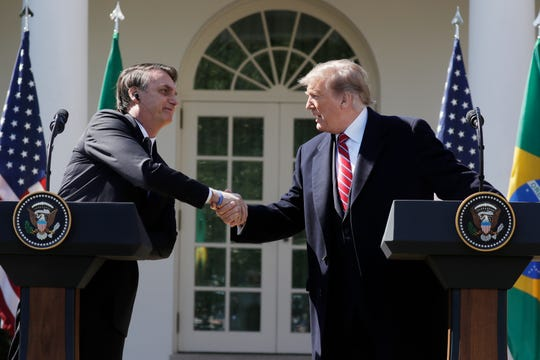 President Donald Trump greets Brazilian President Jair Bolsonaro during a news conference in the Rose Garden at the White House in Washington, D.C., March 19, 2019.