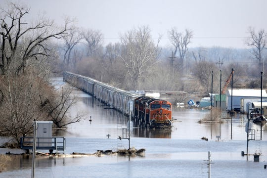 A BNSF train sits in flood waters from the Platte River, in Plattsmouth, Neb. on March 17, 2019.