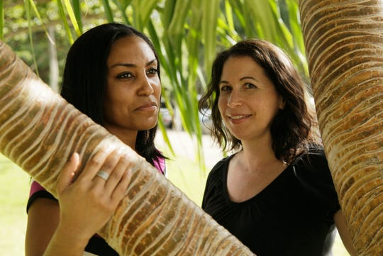 This Dec. 19, 2011 file photo shows Taeko Bufford, left, and Diane Cervelli, right, in Honolulu. The U.S. Supreme Court is rejecting an appeal from a Hawaii bed and breakfast that wouldn't rent a room to the lesbian couple.