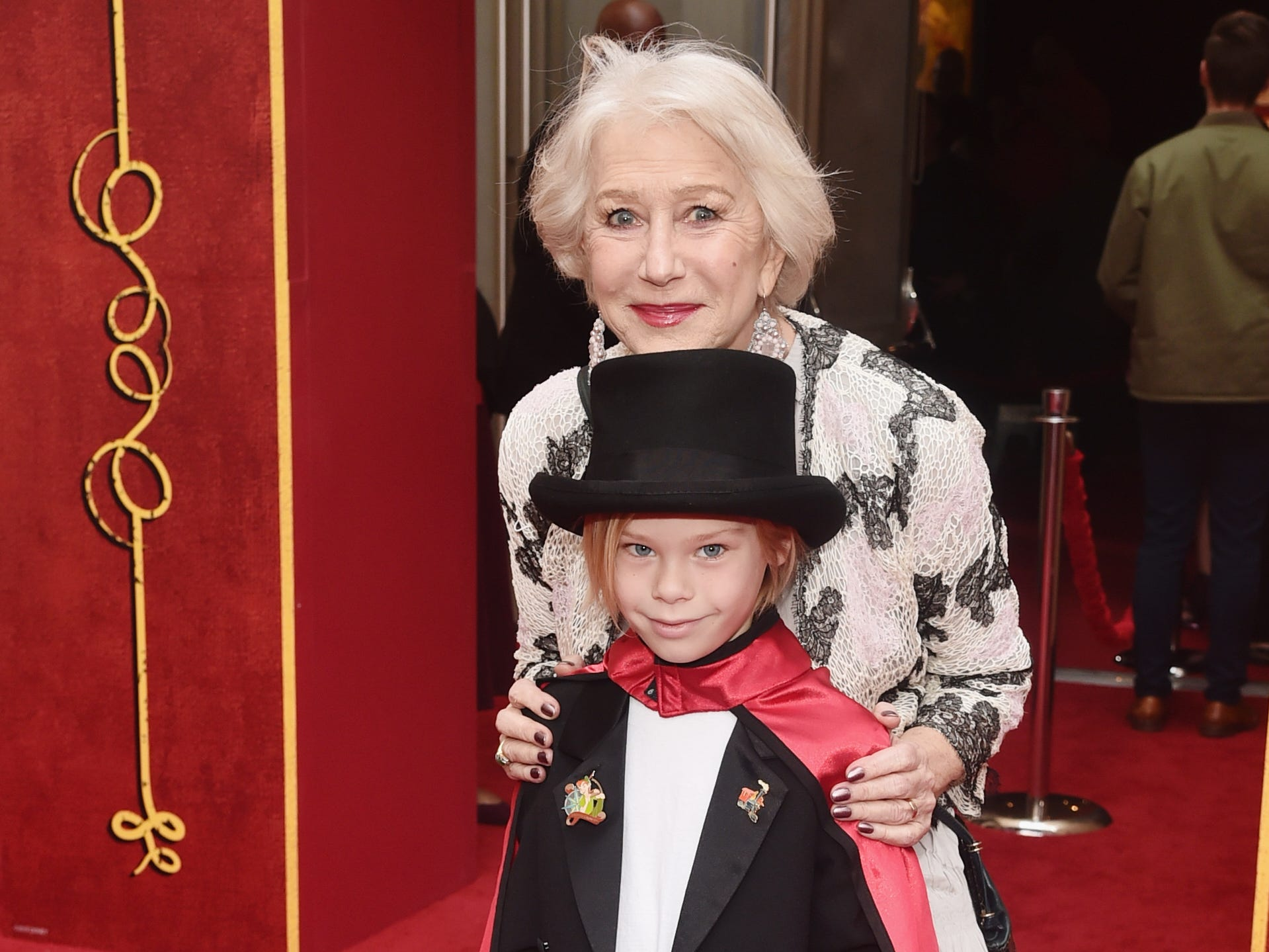 "Helen Mirren poses with grandson Waylon Hackford on the ""Dumbo"" red carpet."
