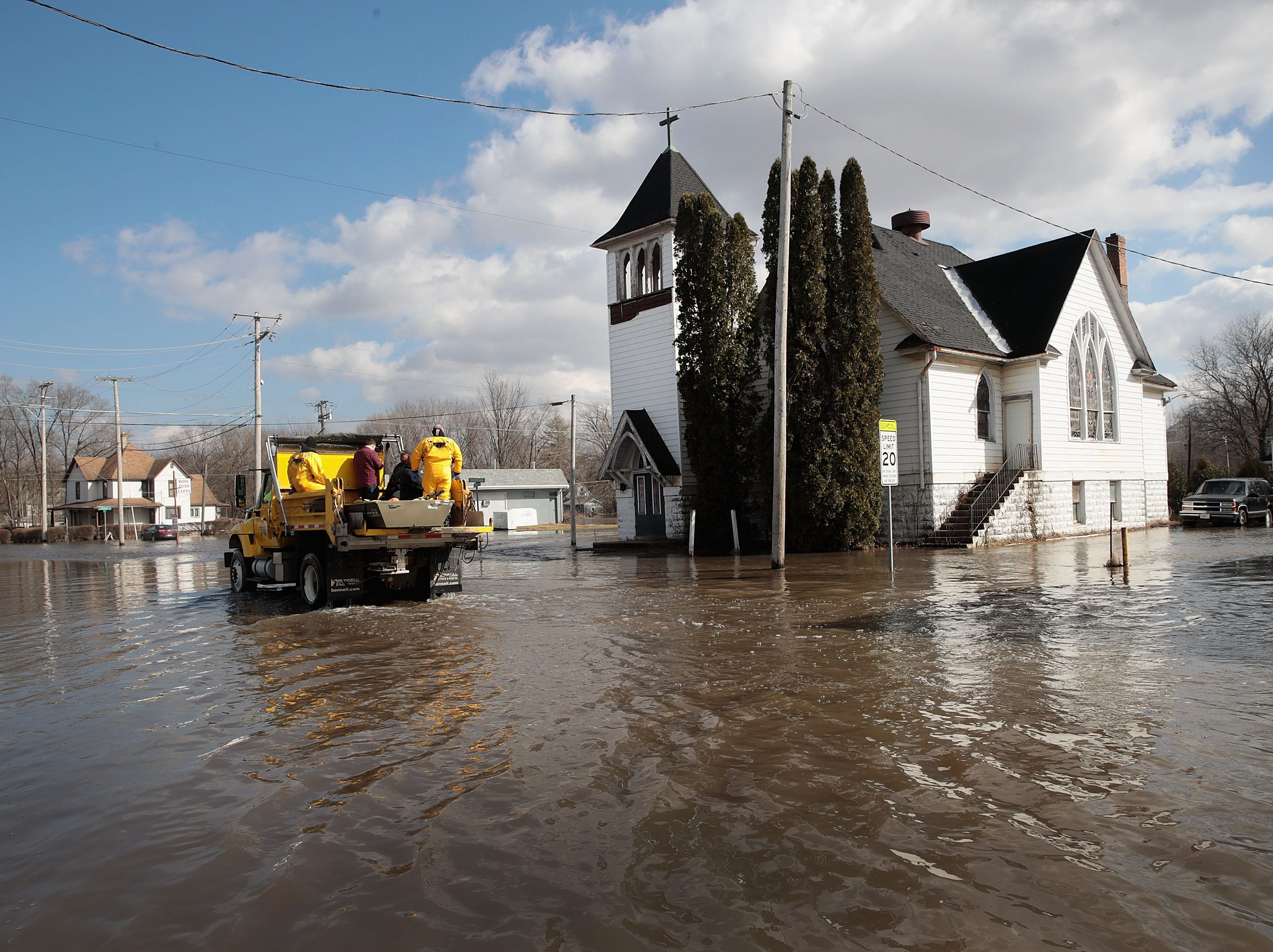 A church is surrounded by floodwater from the Pecatonica River on March 18, 2019, in Freeport, Ill.