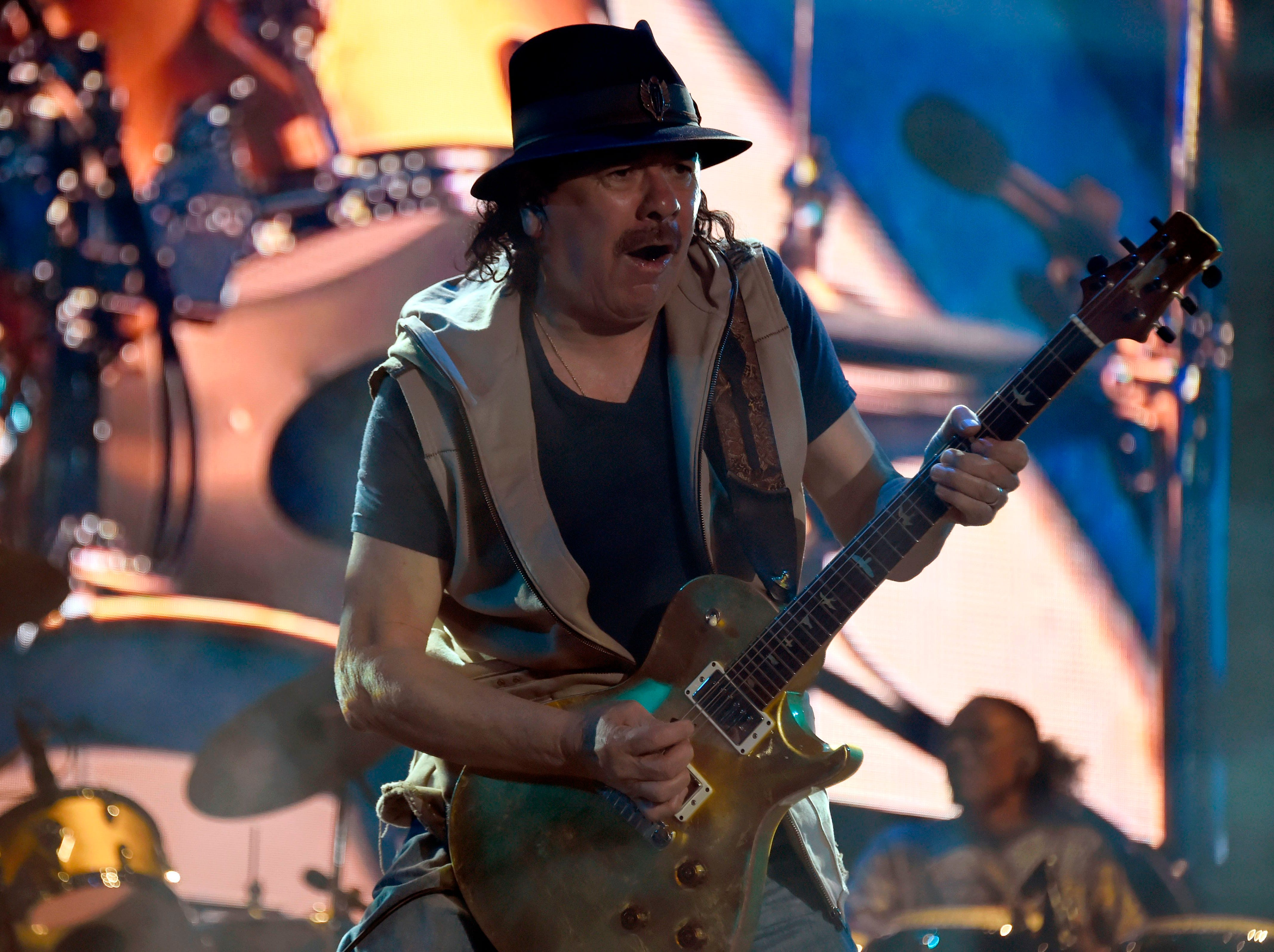 "Mexican born guitar player Carlos Santana performs during the second day of the ""Vive Latino"" music festival in Mexico City on March 17, 2019. (Photo by ALFREDO ESTRELLA / AFP)ALFREDO ESTRELLA/AFP/Getty Images ORIG FILE ID: AFP_1ER7IQ"
