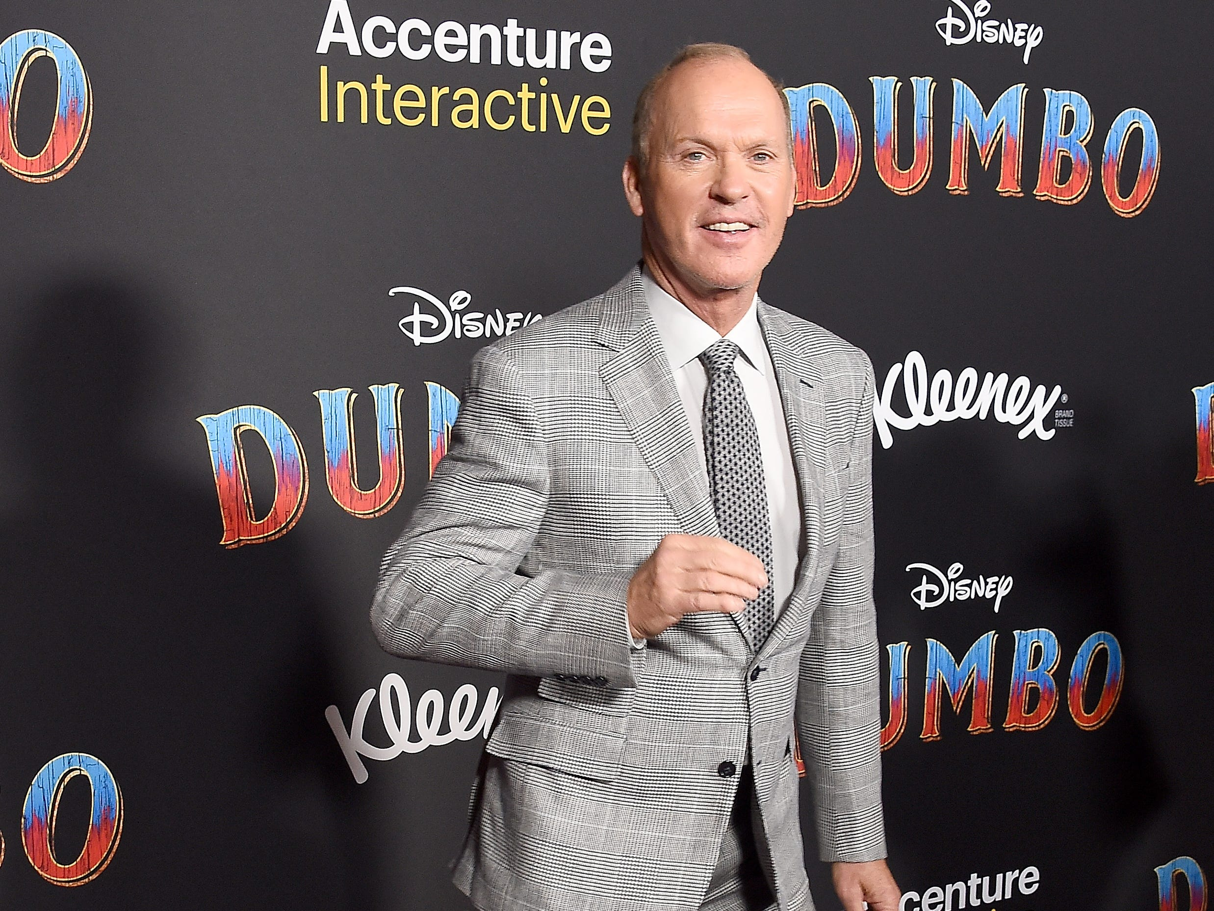"Michael Keaton shows off his moves on the red carpet at the L.A. premiere of ""Dumbo"" on March 11, 2019."
