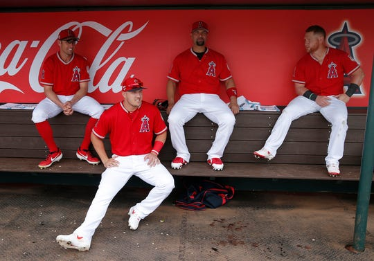 Mike Trout sits with his teammates Peter Bourjos (left), and Albert Pujols (right).