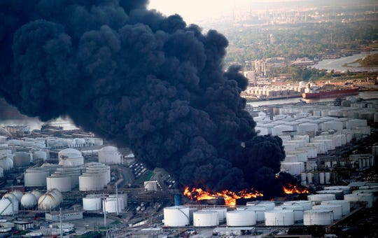 A plume of smoke rising from a petrochemical fire at the InterContinental Terminals Company Monday in Deer Park, Texas.