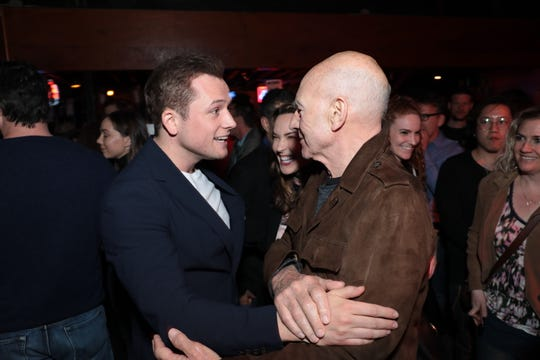 Taron Egerton greets Patrick Stewart after noticing the British thespian from the stage.