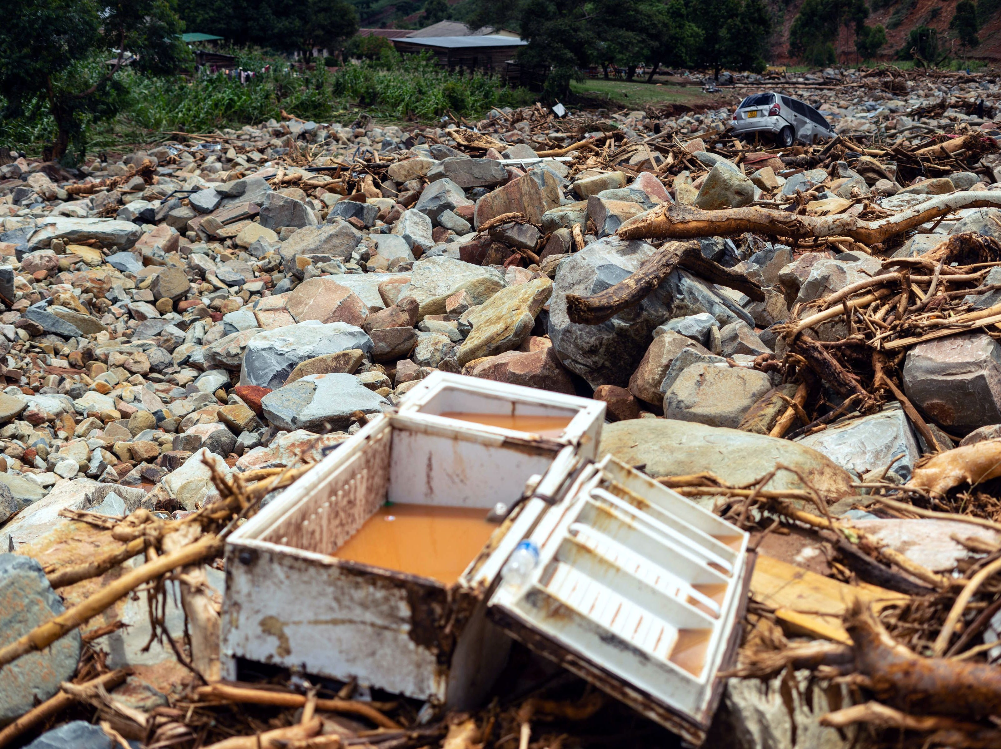 A demolished fridge sits among the rocks and debris  after Chimanimani, Zimbabwe, was hit by the cyclone Idai.