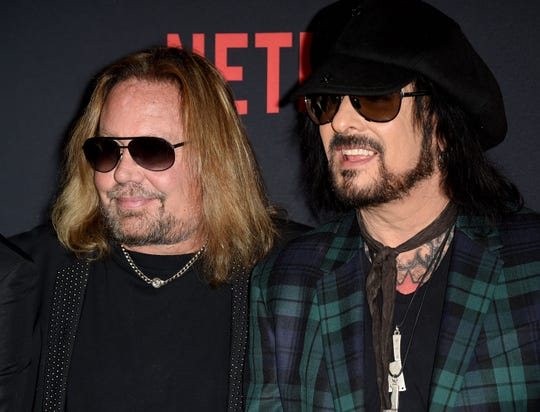 "Vince Neil, left, and Nikki Sixx attend ""The Dirt"" premiere in Hollywood, California, on Monday."