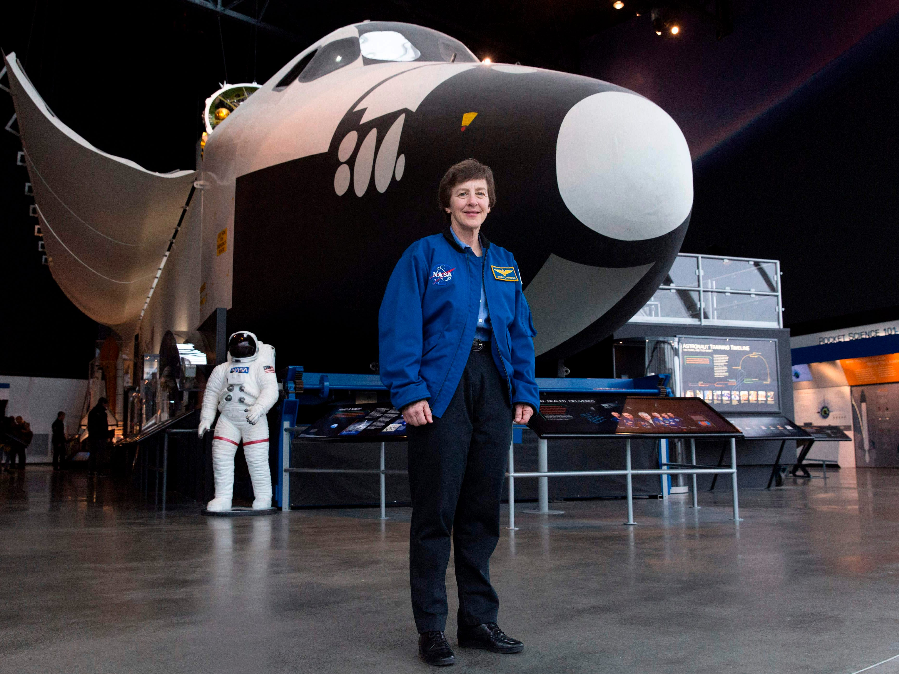 Wendy Lawrence, 58, a retired US Navy captain and former NASA astronaut, is pictured on the Space Shuttle trainer that was used for astronaut's training at the Museum of Flight in Seattle, Washington on February 28, 2018. She was the first female graduate of the United States Naval Academy to fly into space. Her first mission was on the STS-114 in 1995, and then again in 1997, 1998, and 2005.