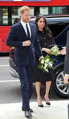 Prince Harry and Duchess Meghan arrive at New Zealand House to sign the book of condolence on March 19, 2019 in London.