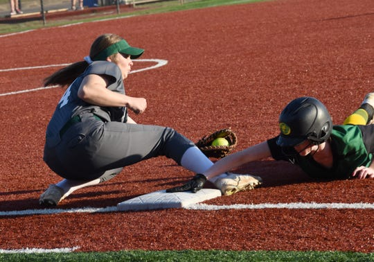 Rapides first baseman Emily Coburn tries to apply the tag against Plainview Tuesday, March 19, 2019 at Louisiana College in Pineville. Plainview won 13-4.