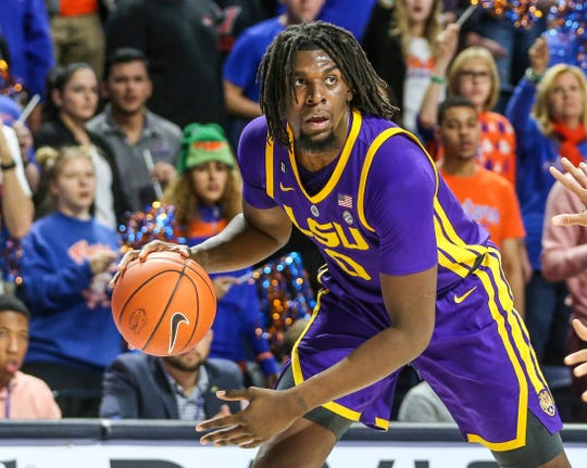 LSU forward Naz Reid (0) looks over the Florida defense during the second half of an NCAA college basketball game in Gainesville, Fla., Wednesday, March 6, 2019.