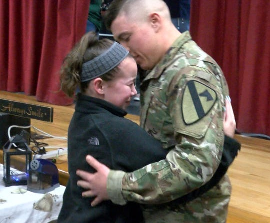 Veterans Memorial Middle School sixth grader Maggie Angrosina hugs her older brother US Army Specialist Matthew Angrosina after he surprised her on his return home from military service Wednesday, March 20, 2019.