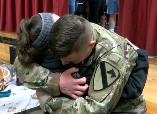 Veterans Memorial Middle School sixth grader Maggie Angrosina shares a hug with her older brother US Army Specialist Matthew Angrosina who surprised her at the school on his return home from military service Wednesday, March 20, 2019.