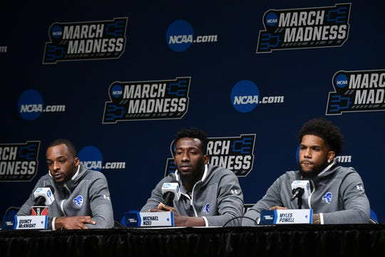 Seton Hall Pirates guard Quincy McKnight (0) , forward Michael Nzei (1) and guard Myles Powell (13) talk to the media during practice