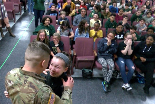 Veterans Memorial Middle School sixth grader Maggie Angrosina cries after she was surprised by her older brother US Army Specialist Matthew Angrosina on his return home from military service Wednesday, March 20, 2019.
