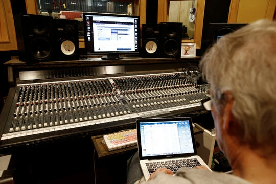 The mixing board adjacent to the studio space at Absolute Music in Hazlet Tuesday, March 19, 2019.