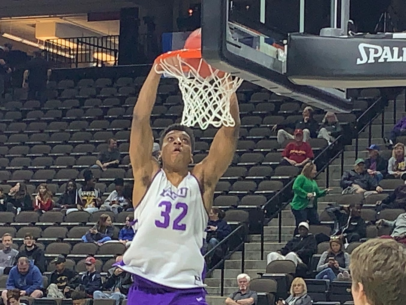 Joe Pleasant (32) dunks during Abilene Christian's practice at VyStar Veterans Memorial Arena in Jacksonville on Wednesday, March 20. ACU plays Kentucky in the NCAA Tournament first round on Thursday night.