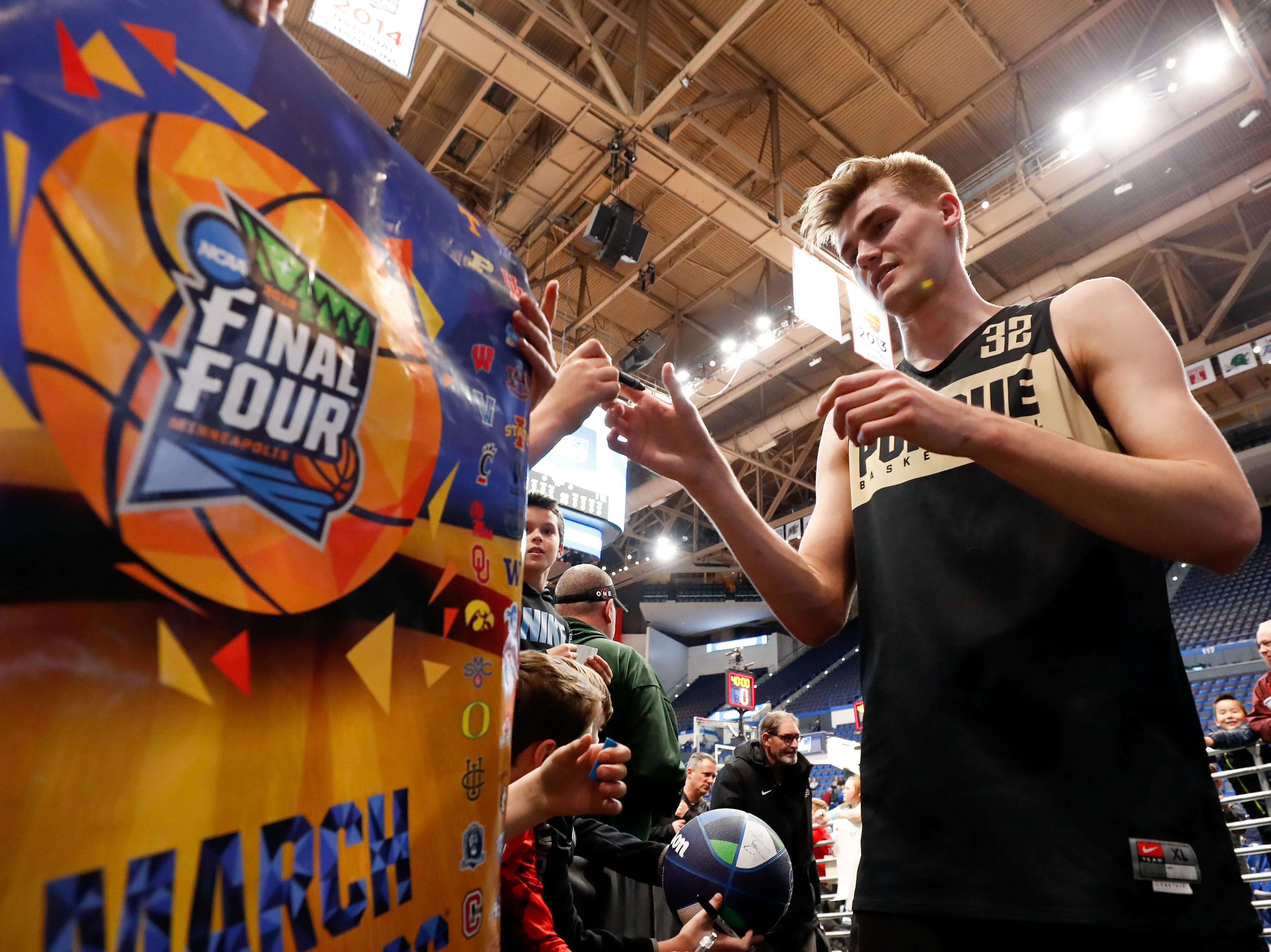 Mar 20, 2019; Hartford, CT, USA; Purdue Boilermakers center Matt Haarms (32) signs an autograph for fans during practice before the first round of the 2019 NCAA Tournament at XL Center. Mandatory Credit: David Butler II-USA TODAY Sports