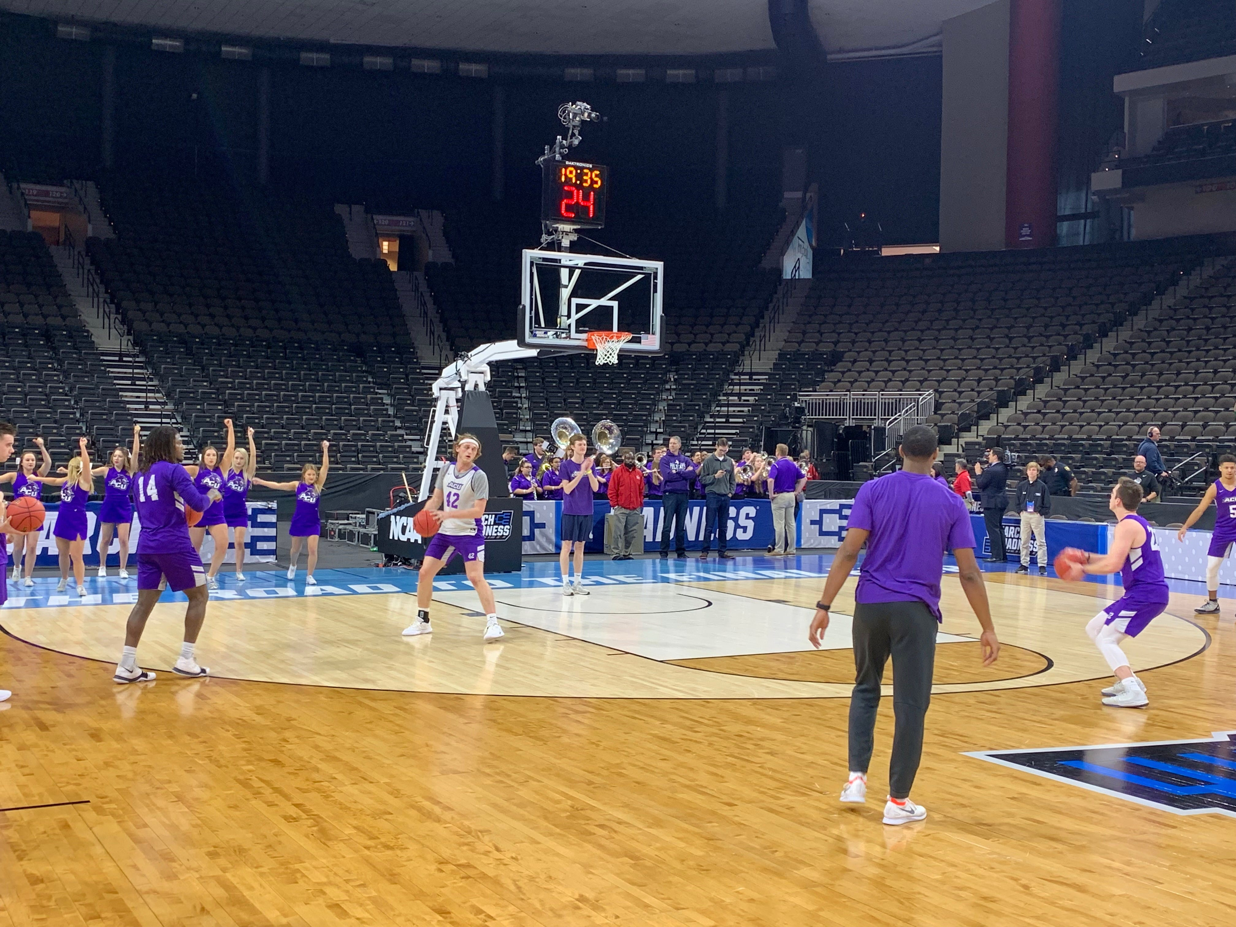 The ACU men's basketball team practices along with the cheerleaders and band at VyStar Veterans Memorial Arena in Jacksonville on Wednesday, March 20. ACU plays Kentucky in the NCAA Tournament first round on Thursday night.