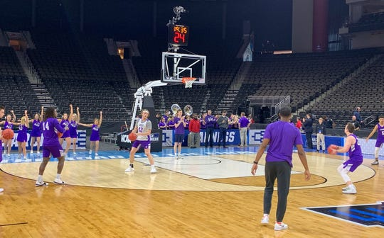 The ACU men's basketball team practices along with the cheerleaders and band at VyStar Veterans Memorial Arena in Jacksonville on Wednesday.