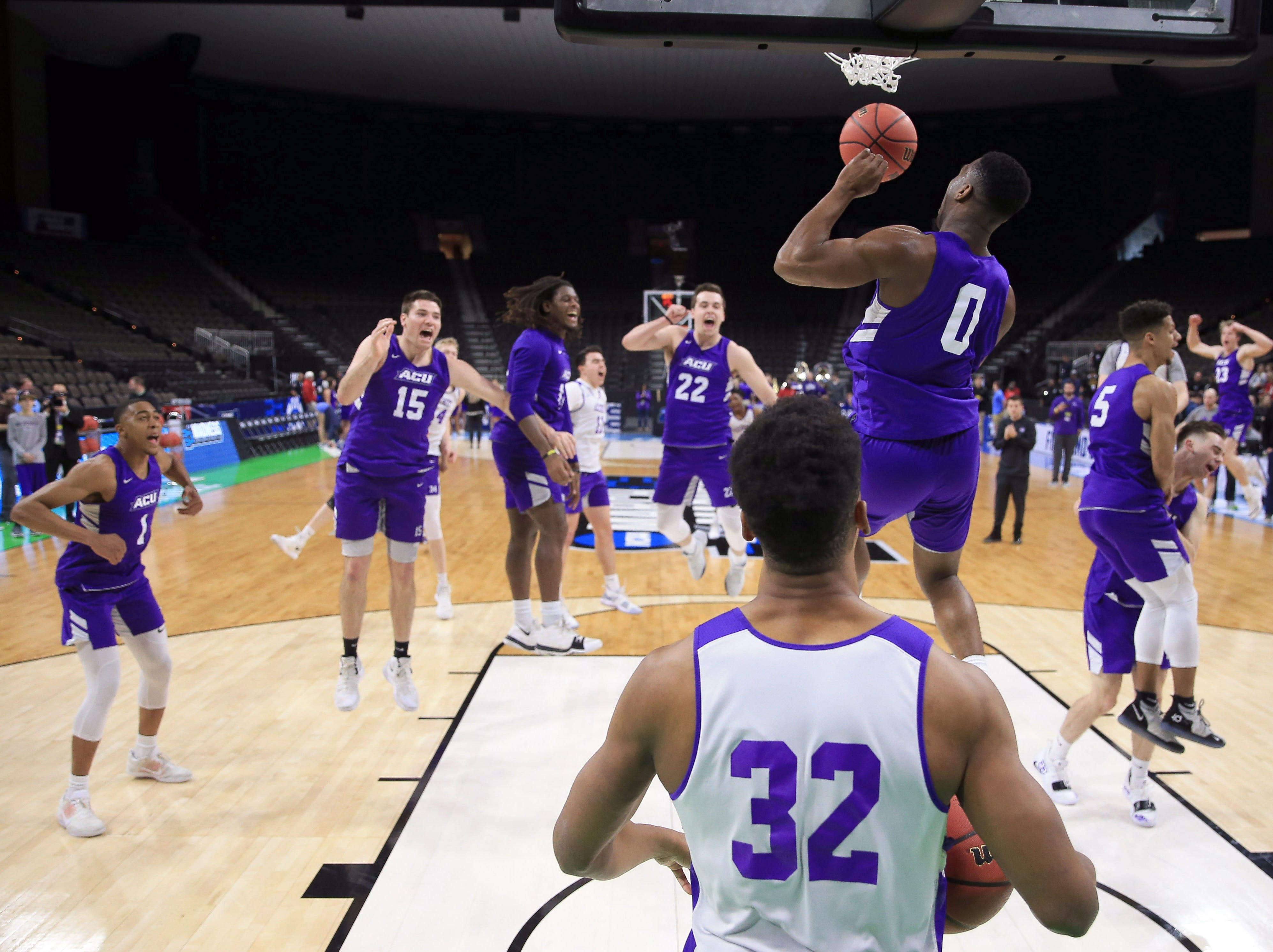 Mar 20, 2019; Jacksonville, FL, USA; Abilene Christian Wildcats guard Jaylen Franklin (0) dunks as the rest of the team celebrates during practice day before the first round of the 2019 NCAA Tournament at Jacksonville Veterans Memorial Arena. Mandatory Credit: Matt Stamey-USA TODAY Sports