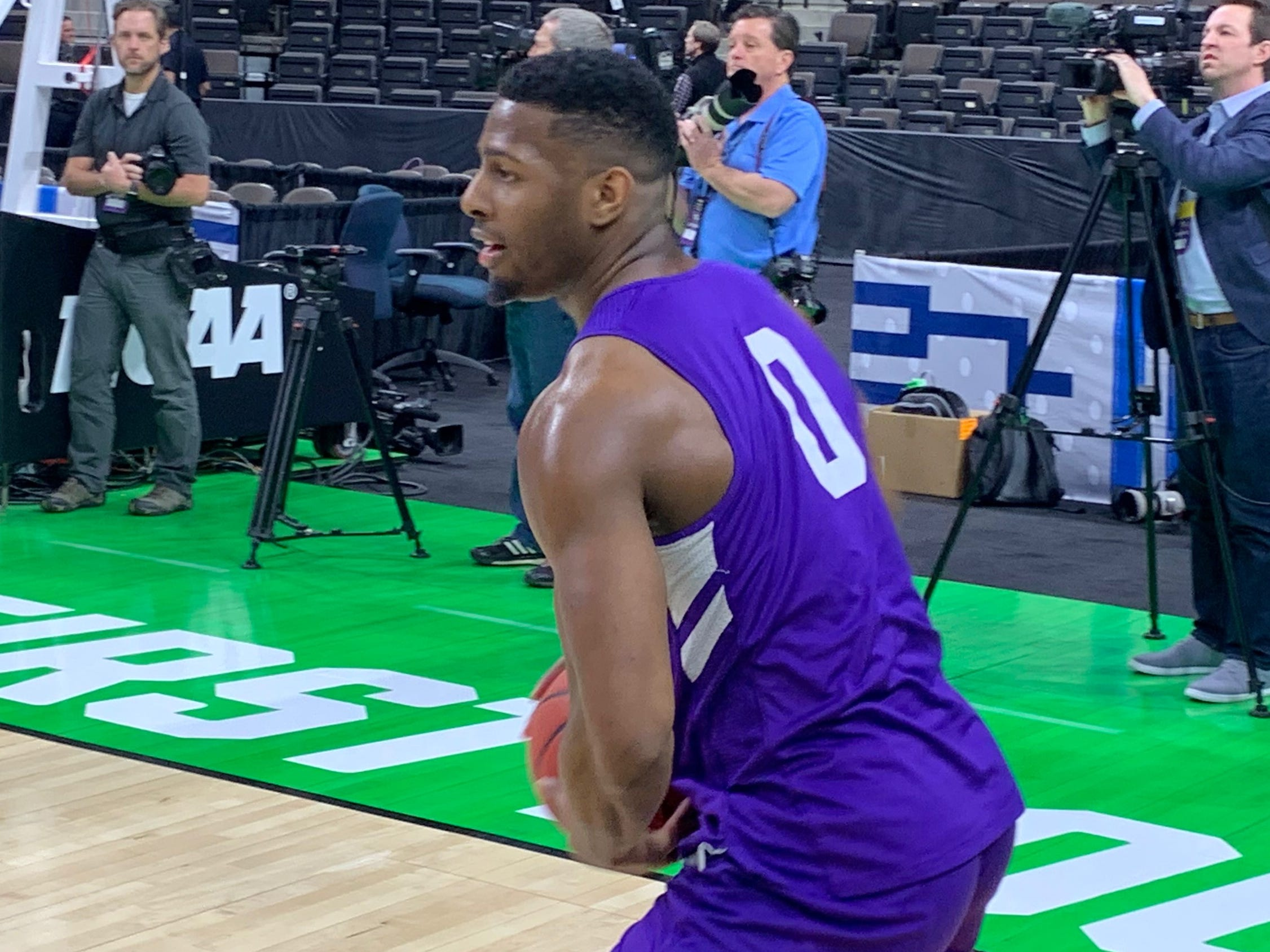 Abilene Christian's Jaylen Franklin (0) turns to make a pass during practice at VyStar Veterans Memorial Arena in Jacksonville on Wednesday, March 20. ACU plays Kentucky in the NCAA Tournament first round on Thursday night.