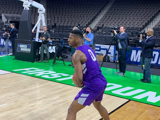 Abilene Christian's Jaylen Franklin (0) turns to make a pass during practice at VyStar Veterans Memorial Arena in Jacksonville on Wednesday. ACU plays Kentucky in the NCAA Tournament first round Thursday night.