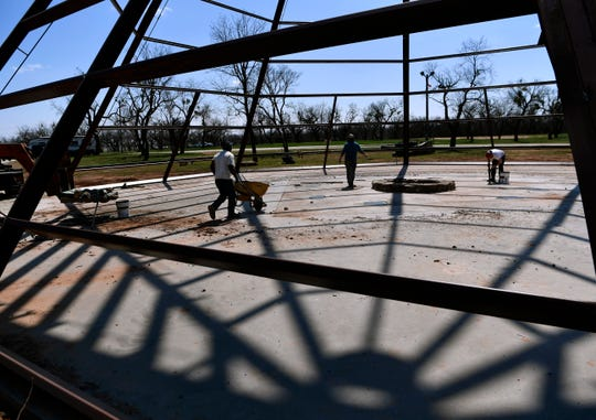 Workers put the finishing touches on the concrete slab of a large steel tipi on the grounds of the Back Porch of Texas on Wednesday. The Outlaws & Legends music festival starts Friday.