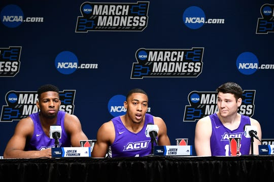 Mar 20, 2019; Jacksonville, FL, USA; Abilene Christian Wildcats guard Jaylen Franklin (0) , forward Jaren Lewis (1) and forward Hayden Farquhar (15) talk to the media during practice day before the first round of the 2019 NCAA Tournament at Jacksonville Veterans Memorial Arena. Mandatory Credit: John David Mercer-USA TODAY Sports